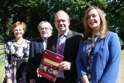 Photo caption: Mary Black (Assistant Director of Public Health, Public Health Agency), Seamus McAleavey (Chief Executive, NICVA), Dr Michael McBride (Chief Medical Officer) and Joanne Morgan (Director, Community Development and Health Network) launch the new report – 'Expansion of Community Development Approaches'.